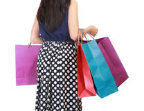 Beautiful woman with a lot of shopping bags. Isolated on white background Stock Image