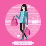 Beautiful woman with a lot of shopping bags Stock Photos