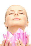 Beautiful woman with lotus flower Stock Photography