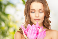 Beautiful woman with lotus flower Stock Image