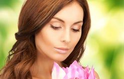 Beautiful woman with lotus flower Stock Photo