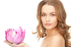 Beautiful woman with lotus flower Royalty Free Stock Photography