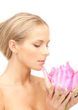 Beautiful woman with lotus flower Royalty Free Stock Photos