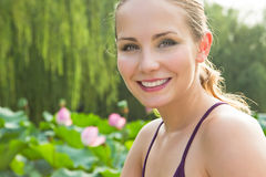 Beautiful woman in the lotus park Stock Images