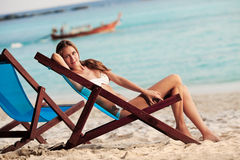 Beautiful woman in lounge on the beach. Thailand Stock Photo
