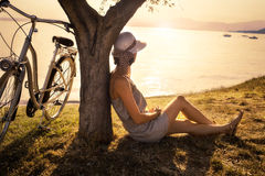 Beautiful woman in love waiting under an olive tree's at sunset Stock Photos