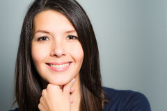 Beautiful woman with a lovely warm smile Stock Photos