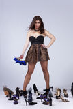 Beautiful woman that loves shoes Royalty Free Stock Photography