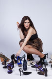 Beautiful woman that loves shoes Stock Image