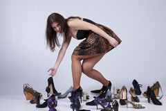 Beautiful woman that loves shoes Royalty Free Stock Photo