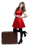 A beautiful woman with a luggage Stock Images