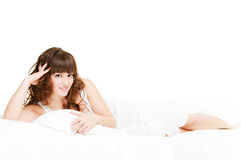 Beautiful woman is luxuriating in bed Stock Photos