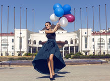 Beautiful woman in luxurious dress with colorful balloons Royalty Free Stock Photo