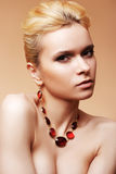 Beautiful woman with luxury hairstyle, necklace. Beautiful woman with luxury back hairstyle, blond hair, gold necklace royalty free stock images