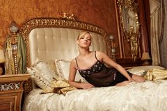 Beautiful woman in a luxury hotel room Royalty Free Stock Photo