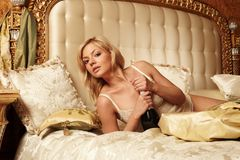 Beautiful woman in a luxury hotel room Royalty Free Stock Image