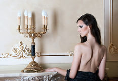 Beautiful woman in luxury interior Royalty Free Stock Photo