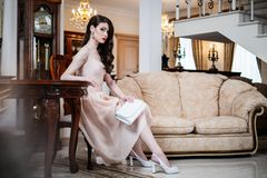 Beautiful woman in luxury interior Stock Photos