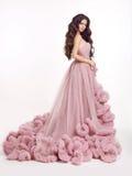 Beautiful woman in luxury lush pink dress. Fashion lady brunette Stock Photography