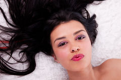 Beautiful woman lying Stock Photography
