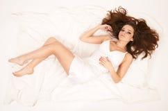 Beautiful woman lying in bed Stock Image