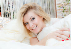Beautiful woman lying in bed Royalty Free Stock Image