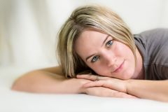 Beautiful woman lying on a bed Royalty Free Stock Photography