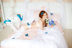 Beautiful woman lying on the bed with flowers Royalty Free Stock Image