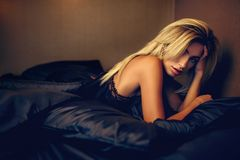 Beautiful woman lying on bed top view Stock Photos