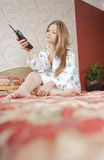Beautiful woman lying in the bedroom Royalty Free Stock Image