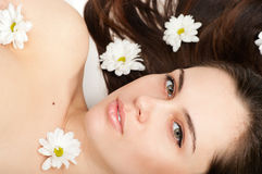 Beautiful woman lying in chamomiles Royalty Free Stock Photography