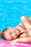 Beautiful woman lying close to pool Stock Photography