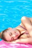 Beautiful woman lying close to pool Stock Photography