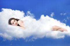 Beautiful woman lying on clouds Royalty Free Stock Photos