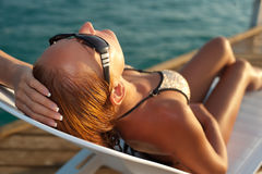 Beautiful woman lying on a deckchair Royalty Free Stock Image
