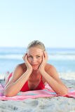 Beautiful woman lying down on the beach Royalty Free Stock Photography