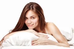 Beautiful woman lying down in bed Royalty Free Stock Photo