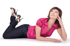 Beautiful woman lying down on floor Royalty Free Stock Photography