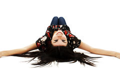 Beautiful woman lying down on floor and smiling Stock Photos
