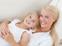 Beautiful woman lying down with her daughter Royalty Free Stock Photography
