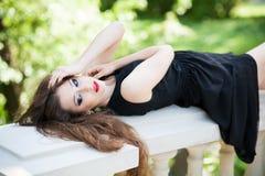 Beautiful woman lying down outdoors Stock Image