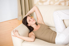 Beautiful woman lying down sleeping on sofa Royalty Free Stock Images
