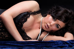 Beautiful woman lying dressed in black lingerie Stock Images