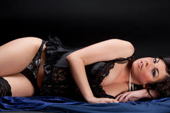 Beautiful woman lying dressed in black lingerie Royalty Free Stock Photo