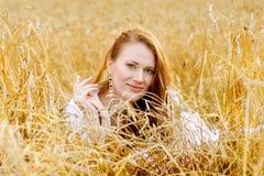 Beautiful woman lying in a field of wheat Stock Image