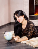 Beautiful woman playing with a globe Royalty Free Stock Image