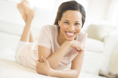 Beautiful Woman Lying On Floor At Home Royalty Free Stock Photo
