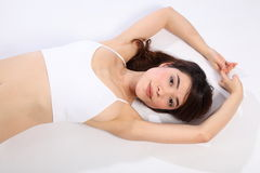 Beautiful woman lying on floor wearing white bra Royalty Free Stock Images