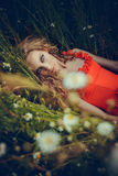 Beautiful woman lying in flowers Stock Photography
