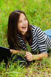 Beautiful woman lying grass Royalty Free Stock Photos